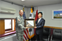 Col. Donald E. Degidio Jr. presents a plaque to Republic of Korea Air Force Col. (Ret.) Han, Bong-wan, the former chief of U.S. Forces Korea Construction Management Division with the Ministry of National Defense Defense Installations Agency.