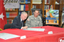 Col. Donald Degidio, commander of the U.S. Army Corps of Engineers Far East District, watches as Dr. Richard Schlenker, Department of Defense Schools Korea District science, technology, engineering, and mathematics (STEM) coordinator, signs an education partnership agreement March 7.  The partnership between USACE and DoDDS Korea District will center on support for the STEM initiative.  (Photo by Patrick Bray)
